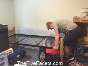 Big Guy & Warren Raising the Dorm room bed