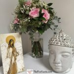 Buddha, Flowers, and Angel at The Five Facets office